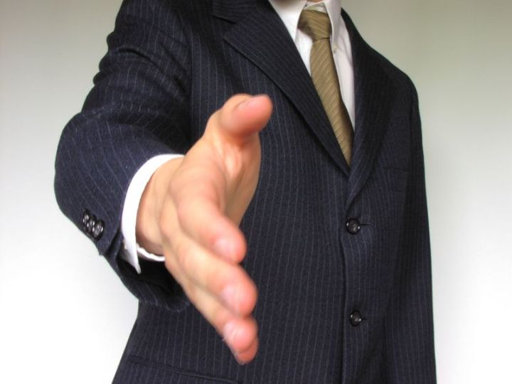1720-business-man-offering-hand-shake-or